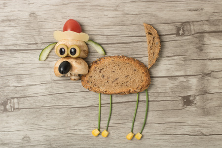 Funny dog in Santa hat made with food Stock Photo