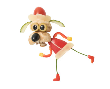 Running dog in Santa outfit made with vegetables