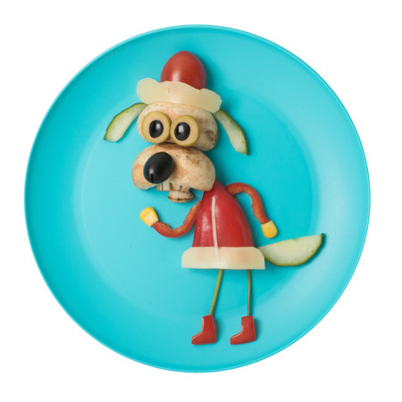 Dog made as Santa with fresh vegetables Stock Photo