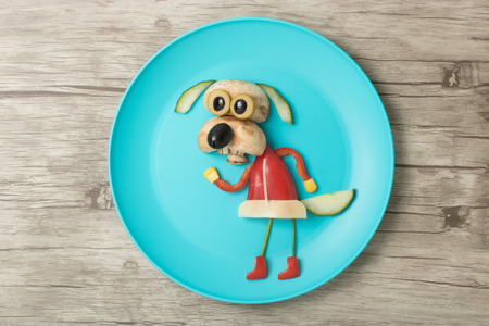 Funny vegetable dog on plate and wood Stock Photo