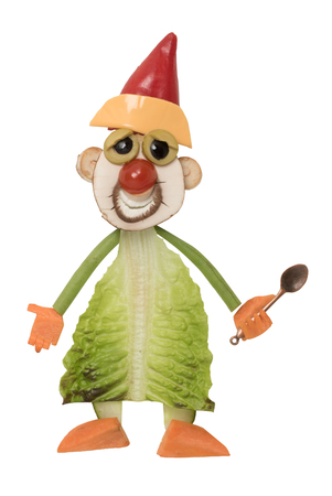 Cook in Santa hat made with fresh vegetables Stock Photo