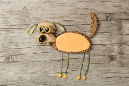 Surprised dog made with bread and vegetables