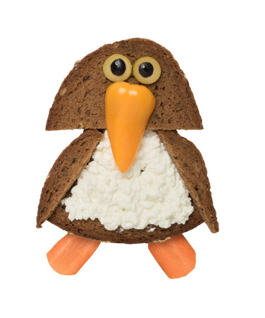 Funny penguin made with black bread and vegetables Stock Photo