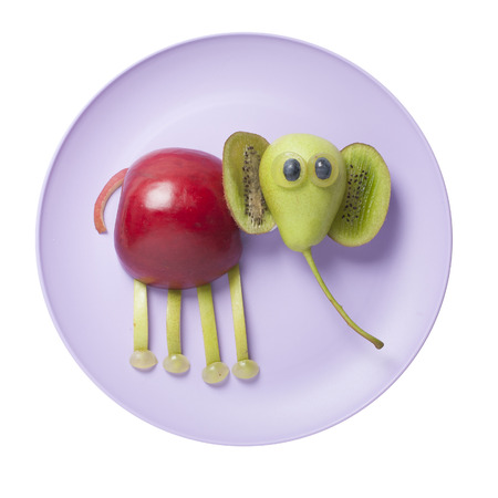 Funny elephant created from fruits on plate