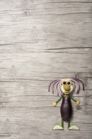 Funny vegetable man made on wooden background Stok Fotoğraf