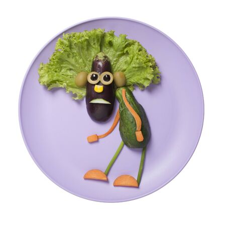 Funny idea of making a human with eggplant, cucumber and salad