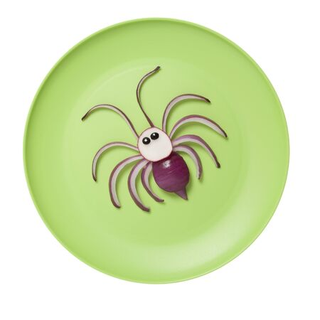 Idea of making a spider with onion on green plate Stok Fotoğraf