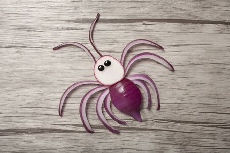 Creative receipt for making a spider with red onion Stok Fotoğraf
