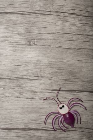 Spider made with red onion on wooden background Stok Fotoğraf