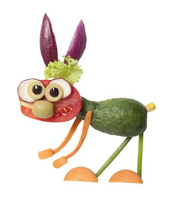 Funny rabbit made from fresh vegetables on isolated background