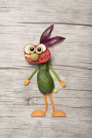 Surprised vegetable rabbit made on wooden board