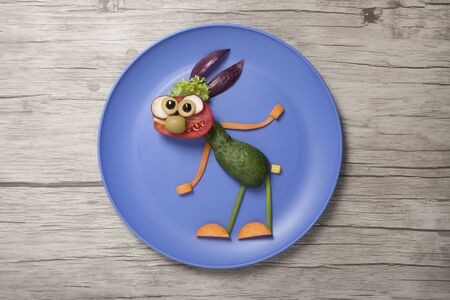 Rabbit made from vegetables in funny pose