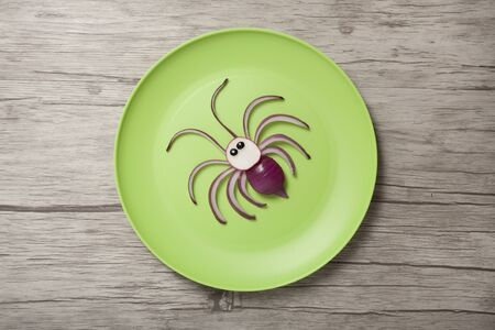 Idea for making a spider with fresh vegetables