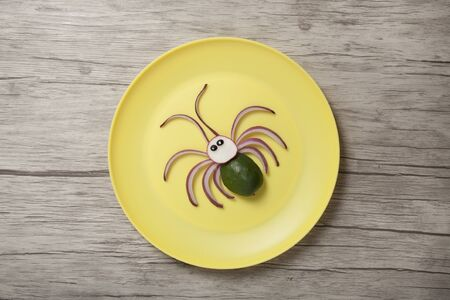Creative idea of making a spider with cucumber and onion