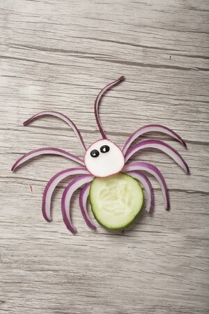 Funny spider made with fresh vegetables on board Stok Fotoğraf