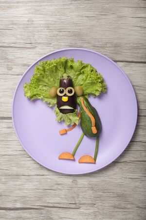 Funny vegetable granddad shot on plate and board