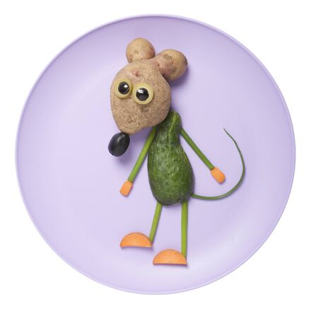 Mouse compiled from fresh vegetables on purple plate