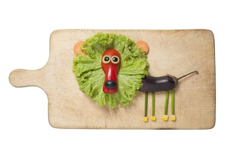 Funny lion compiled with vegetables on cutting board Stok Fotoğraf