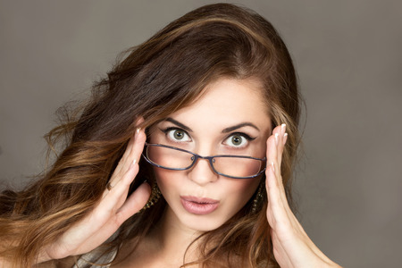 lass: the beautiful girl the brown-haired woman, a look over points Stock Photo