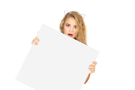 'hide out': young woman peeking from behind the advert. isolate on a white background