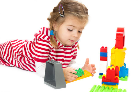 handcarves: girl with toys. white background Stock Photo