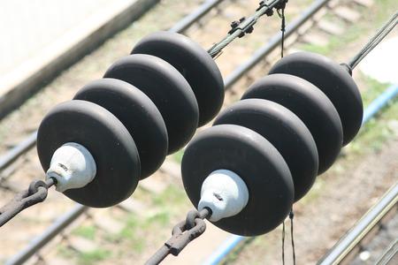 insulators: two insulators on railway wires Stock Photo