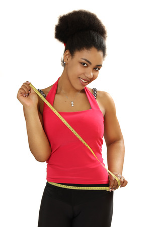 measures: black girl measures a waist. isolated on white background