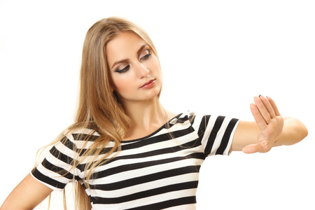 pretty young woman looking at manicure. isolated on a white background