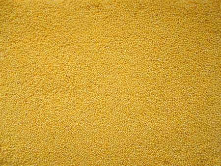A large mound of millet of the highest grade. Top view, close-up. Stock Photo