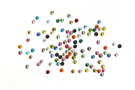 Many strewn with multi-colored rhinestones. On a white background