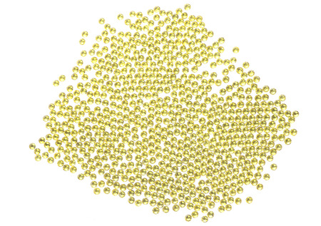 Many scattered rhinestones. On a white background Stock Photo
