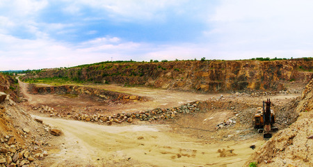 sand quarry: panorama of granite quarry with Loader Stock Photo