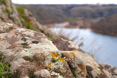 the crag: river, nature, mountain, crag, stone, moss, lichen, background, travel, granite, outdoors, view, high, land, hill, adventure, tall, rocks, cliff, terrain, landscapes, waters, rock, color, texture, closeup, yellow, natural, water, colorful, front, outdoor,