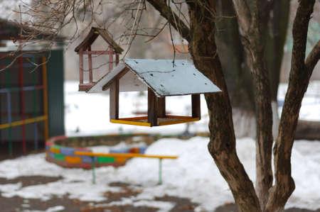 Bird feeders on the playground Stock Photo