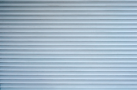 Background of white metal horizontal blinds
