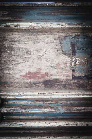 background from an old rusty metal sheet with faded rough frayed shabby paint 写真素材