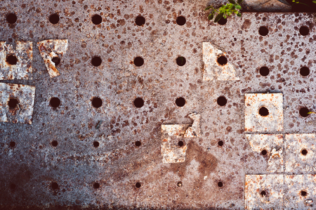 background of old darkened scuffed and scratched gray concrete floor with remnants of floor tiles and rust Stock Photo