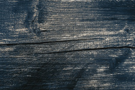 Old, faded, darkened by time, gray knotty horizontal wooden plank close-up 스톡 콘텐츠