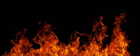 Colorful orange-red bright flame blazing fire. Burning fire on black background close-up. Horizontal background.