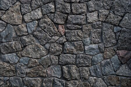 Background texture of old rough granite stones