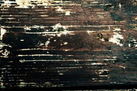 Old, faded, darkened by time, gray knotty horizontal wooden plank close-up Banco de Imagens
