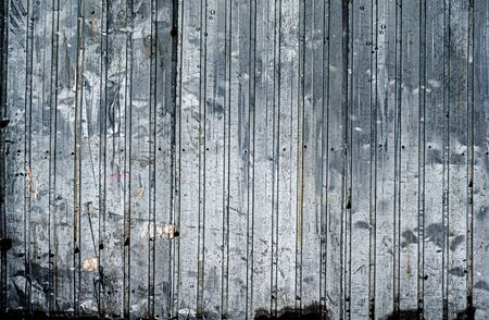 Old galvanized sheet fence. Abstract background. Horizontal photo. Close-up. Corrugated steel surface. Outdoors. Fencing and building floors. Metal boxes, containers. High strength. Stock fotó