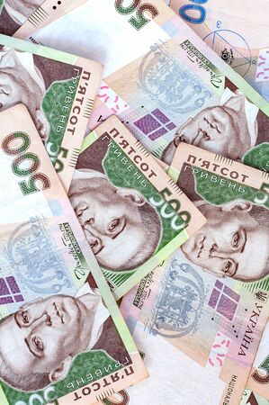 National currency five hundred hryvnia. Vertical background. Background from banknotes Ukrainian hryvnia. Randomly scattered denominations five hundred hryvnia. National currency. Ukrainian money.