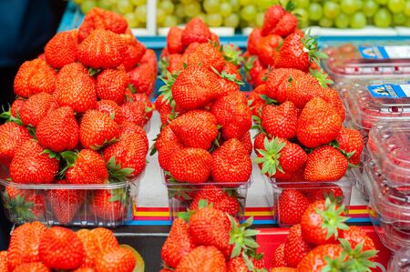Sale juicy, fresh strawberries, blackberries in market square, Prague, Czech Republic. Nutritious healthy berry diet food. Berries close up.