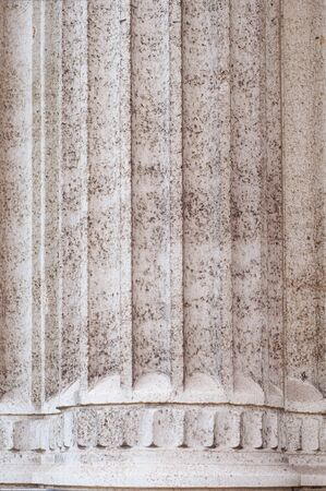 Antique stone pillar in renaissance architecture close-up. Marble natural material.