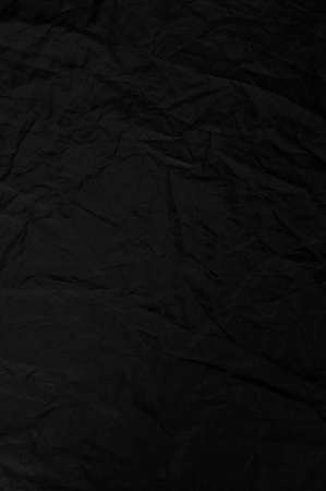 Texture black fabric reflector, a simple, stretched background, vertical photo.