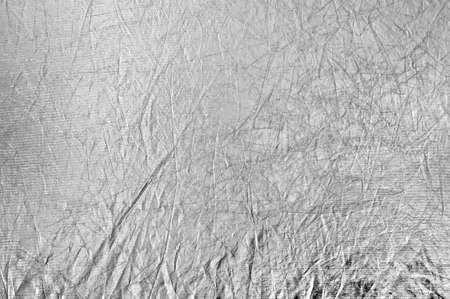 Texture silvery fabric reflector, simple background, horizontal photo. Stock Photo