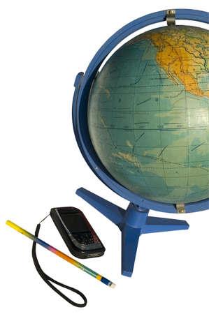 intercommunication: Terrestrial globe and cellular phone on white background