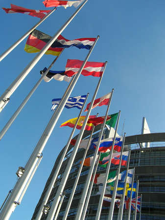 The flags of some countries on background blue sky.  photo