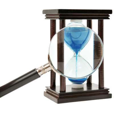 hourglass and loupe isolated on a white                                     photo